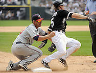CHICAGO - JULY 10:  Danny Valencia #19 of the Minnesota Twins makes a late tag as Gordon Beckham #15 of the Chicago White Sox slides safely into third base during the game against the Chicago White Sox on July 10, 2011 at U.S. Cellular Field in Chicago, Illinois.  The Twins defeated the White Sox 6-3.  (Photo by Ron Vesely)  Subject: Danny Valencia;Gordon Beckham