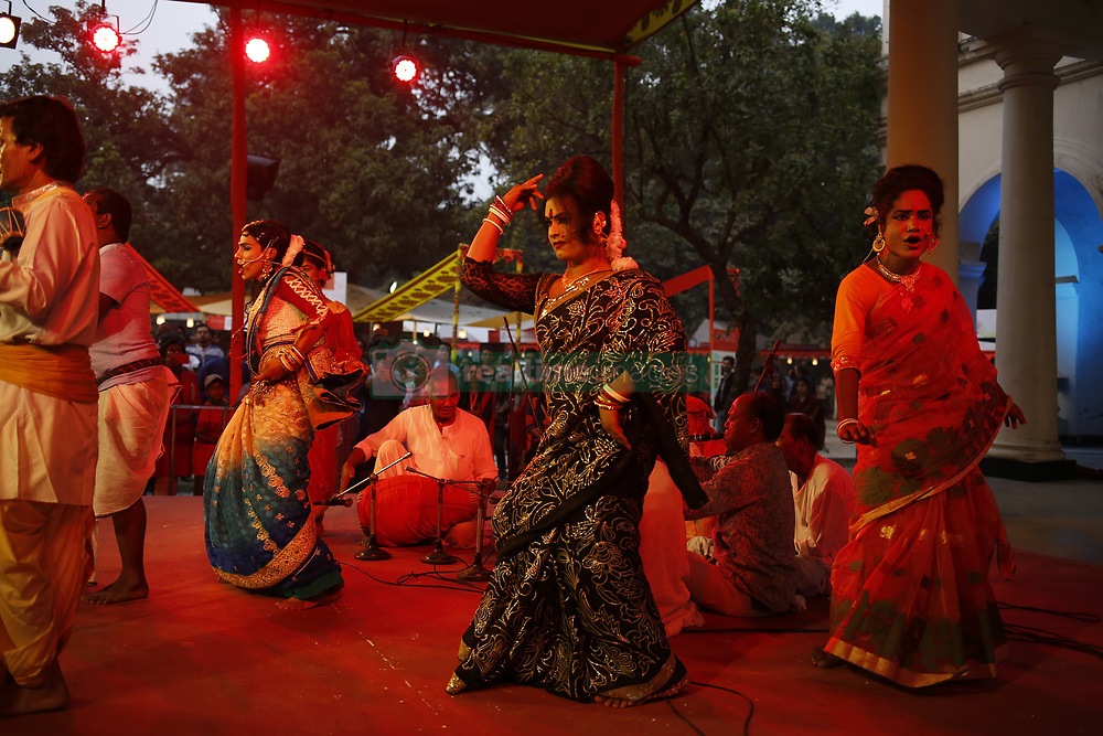 """November 10, 2018 - Dhaka, Bangladesh - A group of Artists performing """"Kushan Gaan"""" an indigenous performing art from performing on Dhaka Lit Fest (an annual literary festival) near the Burdwan house of Bangla Academy, this type genre as an aesthetically rich ritualistic once very  popular practice which occasionally  perform in the North Bengal region. (Credit Image: © MD Mehedi Hasan/ZUMA Wire)"""