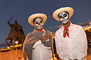 Students dressed as peasant skeletons during the Day of the Dead festival in the Plaza Civica October 28, 2016 in San Miguel de Allende, Guanajuato, Mexico. The week-long celebration is a time when Mexicans welcome the dead back to earth for a visit and celebrate life.