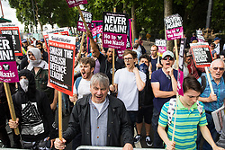 """© Licensed to London News Pictures . 24/06/2017. London, UK. Anti fascists on Embankment . The English Defence League ( EDL ) hold a March on Parliament , from Charing Cross to Victoria Embankment , opposed by  a counter demonstration by Unite Against Fascism . Scotland Yard said it was using public order laws to restrict the marches """"due to concerns of serious public disorder, and disruption to the community"""" following terrorist attacks in Manchester , Westminster and Finsbury Park and the Grenfell Tower fire  . Photo credit: Joel Goodman/LNP"""