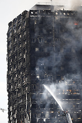 June 14, 2017 - London, UK - Fire engines try to get the Grenfell Tower fire under control after the fire broke in west London. At least six people have died in the blaze. (Credit Image: © Tolga Akmen/London News Pictures via ZUMA Wire)