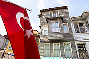 Turkish flag and traditional architecture of homes in the area of Kariye Muzesi, Edirnekapi in Istanbul, Republic of Turkey