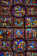 Medieval Windows of the Gothic Cathedral of Chartres, France, dedicated to St Martin of Tour.    A UNESCO World Heritage Site. In the top central oval panel St Martin is ordained Bishop of Tour, box below left Martin is attacked by brigands. Bottom central oval panel shows Martin being baptised. .<br /> <br /> Visit our MEDIEVAL ART PHOTO COLLECTIONS for more   photos  to download or buy as prints https://funkystock.photoshelter.com/gallery-collection/Medieval-Middle-Ages-Art-Artefacts-Antiquities-Pictures-Images-of/C0000YpKXiAHnG2k