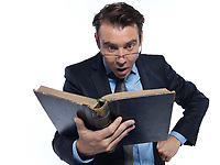 one man caucasian professor teacher teaching  reading an ancient book isolated studio on white background