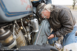 Doc Hopkins doing a side-of-road repair to get his 1915 Harley-Davidson running after dropping a chain on the highway during the Motorcycle Cannonball Race of the Century. Stage-10 ride from Pueblo, CO to Durango, CO. USA. Tuesday September 20, 2016. Photography ©2016 Michael Lichter.