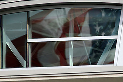 08 November 2014: The American Flag reflects in the windows of the Kaufman Football Building during an NCAA Missouri Valley Football Conference game between the Youngstown State Penguins and the Illinois State Redbirds at Hancock Stadium in Normal Illinois