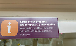 © Licensed to London News Pictures. 27/08/2021. London, UK. 'Some our products are temporarily unavailable' sign displayed on an empty shelf in Sainsbury's, north London. UK food producers and supermarkets are warning that empty shelves could continue unless the government acts to resolve the shortage of workers and lorry drivers, caused by Brexit and the coronavirus pandemic. Photo credit: Dinendra Haria/LNP