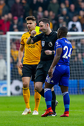 January 19, 2019 - Wolverhampton, England, United Kingdom - Referee Christopher Kavanagh gives Nampalys Mendy of Leicester City yellow card during the Premier League match between Wolverhampton Wanderers and Leicester City at Molineux, Wolverhampton, UK. On Saturday 19th January 2019. (Credit Image: © Mark Fletcher/NurPhoto via ZUMA Press)
