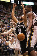 Spurs guard Tony Parker (9) loses possession of the ball under the hoop during the second half of the NBA basketball game between the Utah Jazz and the San Antonio Spurs at Energy Solutions Arena, Wednesday, Dec. 12, 2012.