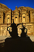 """Tea kettles silhouetted in front of the rock-hewn Monastery in Petra, which was recently named one of the """"Seven Modern Wonders of the World"""" - Jordan."""