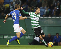 December 1, 2017 - Lisbon, Portugal - Sporting's forward Bas Dost (R) vies with Belenenses's defender Goncalo Silva during the Portuguese League  football match between Sporting CP and CF Belenenses at Jose Alvalade  Stadium in Lisbon on December 1, 2017. (Credit Image: © Carlos Costa/NurPhoto via ZUMA Press)