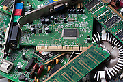 Electronic scrap. Pile of discarded computer components and other electronic waste. Modern electronic equipment contains many potentially polluting substances, including lead, cadmium, mercury, barium and various plastics. The fast development of computer and communications technology means that equipment rapidly becomes outdated, generating large amounts of scrap. To prevent environmental damage, many countries have initiatives to promote the recycling of old equipment and to design products that are less harmful when discarded.
