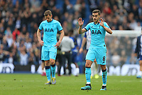 Football - 2019 / 2020 Premier League - Brighton & Hove Albion vs. Tottenham Hotspur<br /> <br /> A very apologetic Harry Winks of Tottenham acknowledges the traveling support after the final whistle at The Amex Stadium Brighton <br /> <br /> COLORSPORT/SHAUN BOGGUST