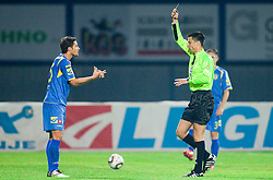 Wilson Xavier Junior of Domzale (L) on the way to wardrobe due to the second yellow card by referee Slavko Vincic (R) during the football match between NK Domzale and MIK CM Celje, played in the 10th Round of Prva liga football league 2010 - 2011, on September 22, 2010, Spors park, Domzale, Slovenia. Domzale defeated Celje 1 - 0. (Photo by Vid Ponikvar / Sportida)