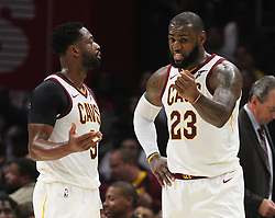 October 17, 2017 - Cleveland, OH, USA - The Cleveland Cavaliers' Dwyane Wade, left, and LeBron James have a discussion before resuming play in the third quarter against the Boston Celtics on Tuesday, Oct. 17, 2017, at Quicken Loans Arena in Cleveland. (Credit Image: © Leah Klafczynski/TNS via ZUMA Wire)