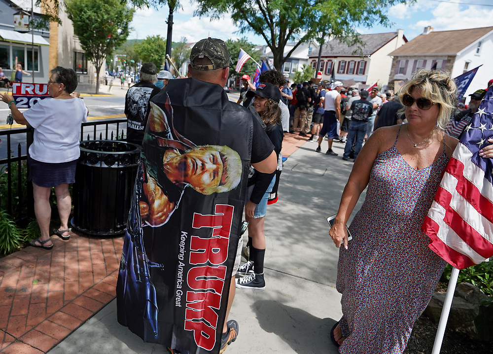 A Pro-Trump Flag Rally was held at the triangle on Chestnut Street in Emmaus, Pennsylvania. Nearly 150 people turned out and voiced their support for the president as a rally of Black Lives Matter supporters held a silent counter-protest in the same spot. (Photo by Matt Smith)