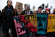 November 21st. Westminster. Demonstration organised by National Union of Students (NUS) against education cuts. Book block - students hold giant book covers including 'Heart of Darkness'.