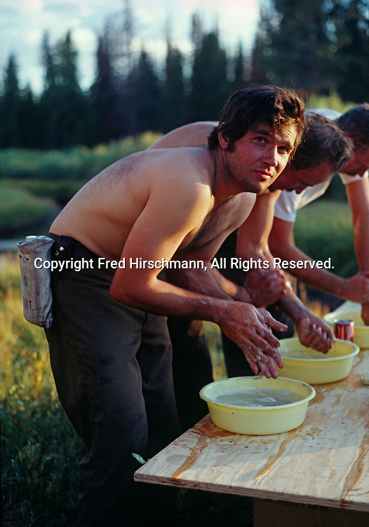 Mike Pflaum washing up after a day of firefighting on the Gniess Creek Fire, 1981, Yellowstone National Park, Wyoming.