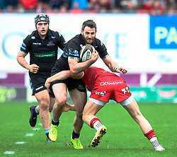 Glasgow Warriors' Tommy Seymour is tackled by Scarlets' Steven Cummins<br /> <br /> Photographer Simon King/Replay Images<br /> <br /> Guinness PRO14 Round 19 - Scarlets v Glasgow Warriors - Saturday 7th April 2018 - Parc Y Scarlets - Llanelli<br /> <br /> World Copyright © Replay Images . All rights reserved. info@replayimages.co.uk - http://replayimages.co.uk