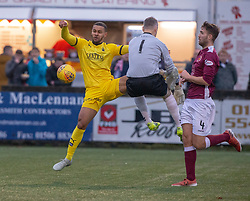 Stenhousemuir's keeper Graeme Smith and Falkirk's Dennon Lewis. Stenhousemuir 4 v 2 Falkirk, 3rd Round of the William Hill Scottish Cup played 24/11/2018 at Ochilview Park, Larbert.