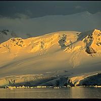 Dawn light illuminates Anvers Island & the Gerlache Strait in the Palmer Archipelago of Antarctica.