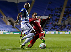 Swansea's Martin Olsson tackles Reading's Leandro Bacuna during the Carabao Cup, third round match at the Madejski Stadium, Reading.