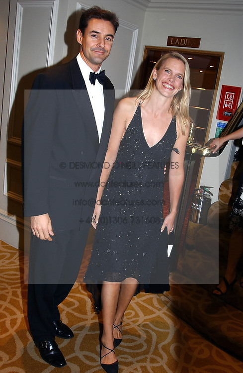 TV presenter ANNA WALKER and MR WILL HARRINGTON at The Caron Keating Foundation Dinner in honour of the late TV presenter who died in April 2004, held at The Savoy, London on 4th October 2004.<br /><br />NON EXCLUSIVE - WORLD RIGHTS
