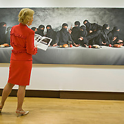 LONDON, ENGLAND - JUNE 04: A Christie's employee looks at 'The last Supper' a re-enactment painting of Leonardo da Vinci by Vivek Vilasini on June 4, 2009 in London, England....***Standard Licence  Fee's Apply To All Image Use***.Marco Secchi /Xianpix. tel +44 (0) 845 050 6211. e-mail ms@msecchi.com or sales@xianpix.com.www.marcosecchi.com