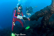 diver Bud Turpin shapes erupting pillow lava by hand to form underwater lava sculptures at ocean entry from Kilauea Volcano, Hawaii Island ( the Big Island ) while son Shane Turpin shoots video Hawaii U.S.A. ( Central Pacific Ocean ) MR 381, 382