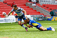Featherstone Rovers centre Misi Taulapapa (4) with a hand off to set up Featherstone Rovers winger Luke Briscoe (5) try during the Challenge Cup 2018 match between Doncaster and Featherstone Rovers at the Keepmoat Stadium, Doncaster, England on 22 April 2018. Picture by Simon Davies.