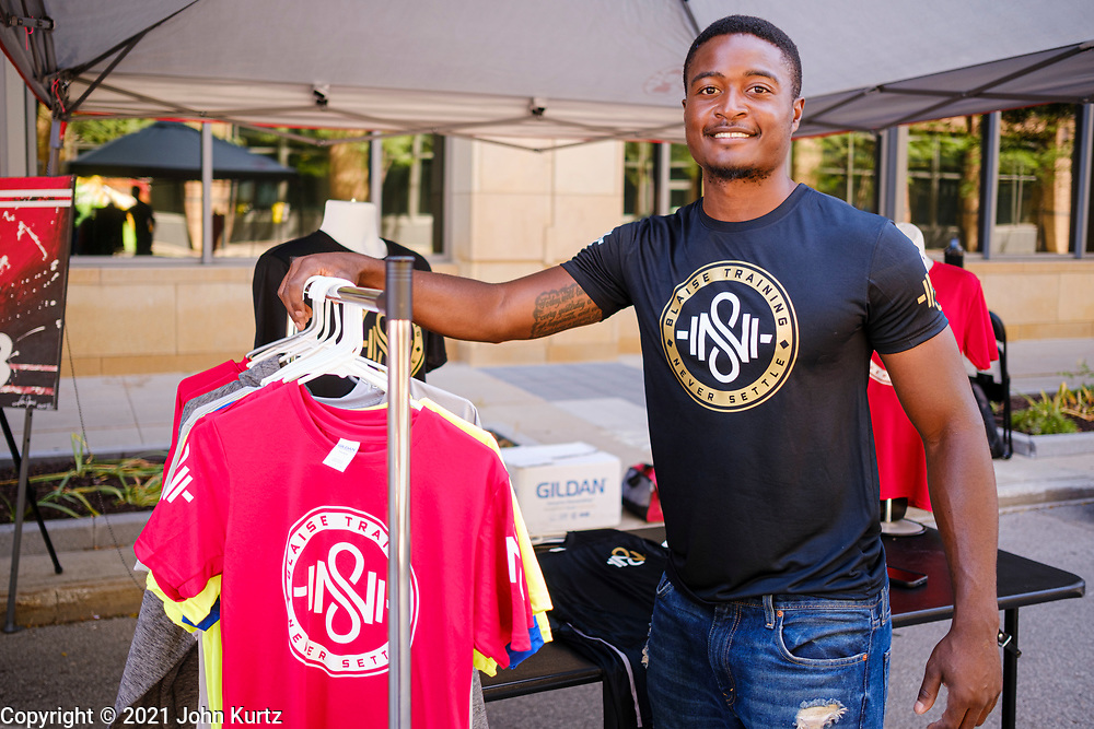 19 JUNE 2021 - DES MOINES, IOWA: MIKAL SETTLE, owner of INSNI Clothing, talks about the importance of Juneteenth in front of his booth, selling his clothing, at the Des Moines Juneteenth festival. Juneteenth marks the day, after the Civil War, that slaves in Texas learned that they were free. Slaves in Texas were freed when Union army General Gordon Granger captured Galveston, Texas, and announced General Order No. 3 proclaiming freedom for slaves held in Texas. Juneteenth has been celebrated in the Black community for more than 100 years. On June 17, 2021, President Joe Biden signed the Juneteenth National Independence Day Act making it a federal holiday.        PHOTO BY JACK KURTZ