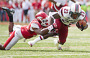 Oct 12, 2013; Fayetteville, AR, USA; South Carolina Gamecock wide receiver Bruce Ellington (23) is brought down by Arkansas Razorback safety Eric Bennett (14) during the first half of a game at Donald W. Reynolds Razorback Stadium. Mandatory Credit: Beth Hall-USA TODAY Sports