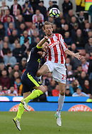 Peter Crouch of Stoke city jumps for a header.. Premier league match, Stoke City v Arsenal at the Bet365 Stadium in Stoke on Trent, Staffs on Saturday 13th May 2017.<br /> pic by Bradley Collyer, Andrew Orchard sports photography.