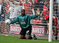 Photo: Paul Thomas.<br /> Walsall v Swansea. Coca Cola League 1.<br /> 27/08/2005.<br /> <br /> Cardiff keeper Willy Gueret can not believe referee M. P. Russell has given Jorge Leitao a goal as they both crash into each and go over the line.