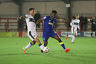 AFC Wimbledon striker Dominic Poleon (10) and Plymouth Argyle defender & captain Gary Miller (2) during the EFL Trophy match between AFC Wimbledon and Plymouth Argyle at the Cherry Red Records Stadium, Kingston, England on 4 October 2016. Photo by Stuart Butcher.