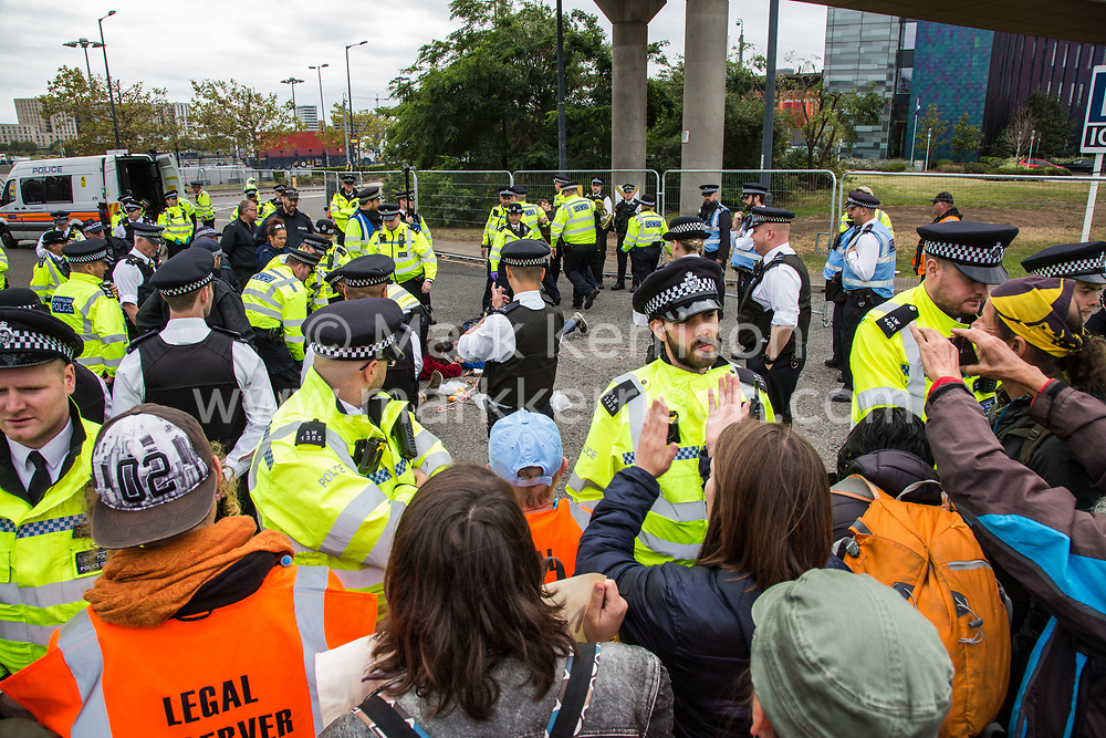 London, UK. 6 September, 2019. Climate activists, including some locked together using arm tubes, block one of the two main access roads to ExCel London during Stop The Arms Fair protests on the fifth day of a week-long carnival of resistance against DSEI, the world's largest arms fair. The road remained blocked for several hours. The fifth day of protests was themed as Stop The Arms Fair: Stop Climate Change in order to highlight links between the fossil fuel and arms industries.