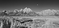 As the sun rose behind me, the nearly full moon set in front of me. This panorama was shot at the Snake River overlook in Grand Teton National Park, Wyoming. Ansel Adams took one of his most popular photos at this same spot.