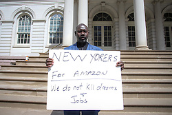March 27, 2019 - New York, New York, United States - Protester is seen at the door of the city hall during the act in favor of the Amazom in the city of New York in the United States the afternoon of this Wednesday, 27  (Credit Image: © William Volcov/ZUMA Wire)