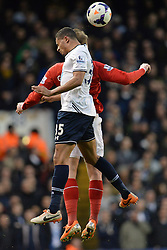 Tottenham's Ezekiel Fryers and Cardiff's Aron Gunnarsson compete for the ball - Photo mandatory by-line: Mitchell Gunn/JMP - Tel: Mobile: 07966 386802 02/03/2014 - SPORT - FOOTBALL - White Hart Lane - London - Tottenham Hotspur v Cardiff City - Premier League