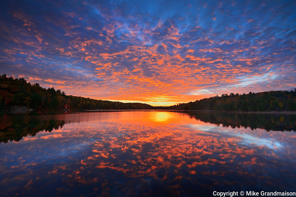 Clouds at sunrise on Raven Lake<br /> Dorset<br /> Ontario<br /> Canada