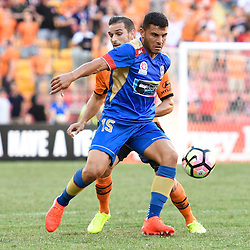 BRISBANE, AUSTRALIA - JANUARY 7: Andrew Nabbout of the Jets and Jack Hingert of the Roar compete for the ball during the round 14 Hyundai A-League match between the Brisbane Roar and Newcastle Jets at Suncorp Stadium on January 7, 2017 in Brisbane, Australia. (Photo by Patrick Kearney/Brisbane Roar)
