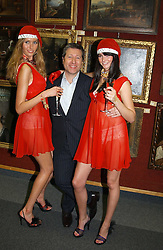 Left to right, model SARAH EL-HINI, DJ NEIL FOX and model GEORGINA PORCHETTA at the Macmillan Cancer Relief Celebrity Christmas Stocking Auction held at Christie's, South Kensington, London on 8th December 2004.<br />