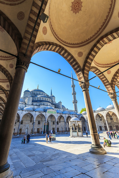 The elevated inner courtyard of Blue Mosque in Istanbul, Turkey.  A fountain in the center of this courtyard was once used for ritual ablutions.