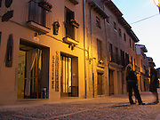 Taken just before the albergue in Estella closed for the evening, two walkers chat in the warm evening air. Albergues or inns for pilgrims on the Camino de Santiago usually close their doors at about 10pm to ensure that everyone gets enough rest for the following day's walk.