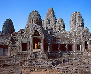 The Temple of Bayonne near Ankor was built by the ruler Jayavarman VII between 1181 and 1200 A.D.  It features stone carvings of Buddha faces on the towers of the third level and it is still a working monastery.