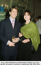 Writer JOHN MORGAN and MRS MARK LITTMAN wife of the top QC. at a party in London on September 30th 1996.LSK 6