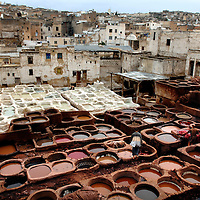 """Fes el Bali, Morocco, 26 October 2006<br /> Leather dyeing vats. (also """"Quartier des Tanneurs"""" / """"The Tanneries"""")<br /> Fes or Fez is the third largest city in Morocco, after Casablanca and Rabat. <br /> It is one of the four so-called """"imperial cities"""" . The Medina of Fes is believed to be the largest contiguous car-free urban area in the world. <br /> Fes el Bali is classified as a UNESCO World Heritage Site.<br /> Photo: Ezequiel Scagnetti"""