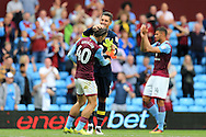 Jack Grealish of Aston Villa (c) celebrates with Pierluigi Gollini, the Aston Villa goalkeeper at  the end of the match. EFL Skybet championship match, Aston Villa v Rotherham Utd at Villa Park in Birmingham, The Midlands on Saturday 13th August 2016.<br /> pic by Andrew Orchard, Andrew Orchard sports photography.