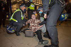 © Licensed to London News Pictures. 05/11/2020. London, UK. Police detain a protestor during the Million Mask March demonstration in central London. On the first day of Britain's second lockdown. Photo credit: Marcin Nowak/LNP