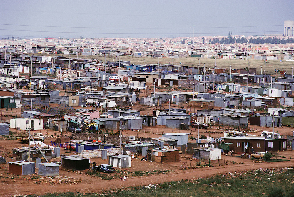 """View of the shantytown called """"Silvertown"""", near Soweto, outside Johannesburg, South Africa. Architecture. Menzel's Material World Project."""